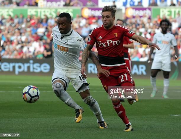 Jordan Ayew of Swansea City against Kiko Femenia of Watford during the Premier League match between Swansea City and Watford at The Liberty Stadium...