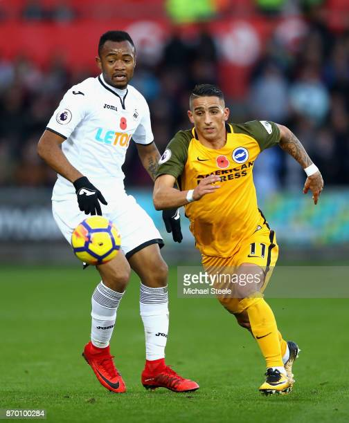 Jordan Ayew of Swansea City and Anthony Knockaert of Brighton and Hove Albion in action during the Premier League match between Swansea City and...