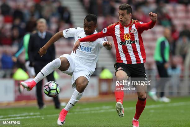 Jordan Ayew of Swansea City and Javier Manquillo of Sunderland battle for possession during the Premier League match between Sunderland and Swansea...