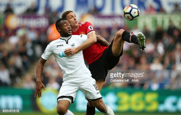 Jordan Ayew of Swansea City and Nemanja Matic of Manchester United during the Premier League match between Swansea City and Manchester United at...