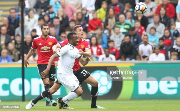 Jordan Ayew of Swansea City is marked by Nemanja Matic of Manchester United during the Premier League match between Swansea City and Manchester...