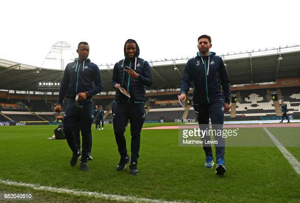 Jordan Ayew of Swansea City Luciano Narsingh of Swansea City and Angel Rangel of Swansea City take a look around the pitch prior to the Premier...