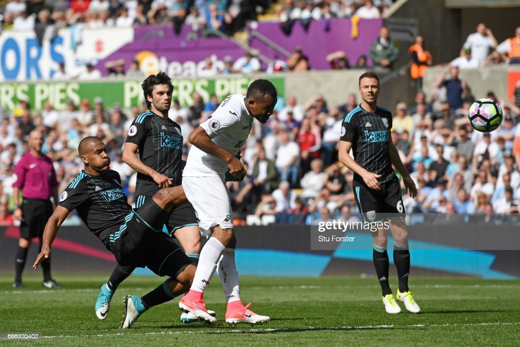 Jordan Ayew of Swansea City scores his sides first goal during the Premier League match between Swansea City and West Bromwich Albion at Liberty Stadium on May 21, 2017 in Swansea, Wales.