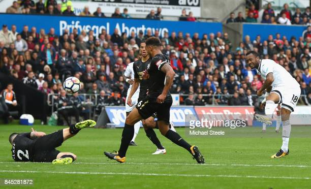 Jordan Ayew of Swansea City shoots on goal during the Premier League match between Swansea City and Newcastle United at Liberty Stadium on September...