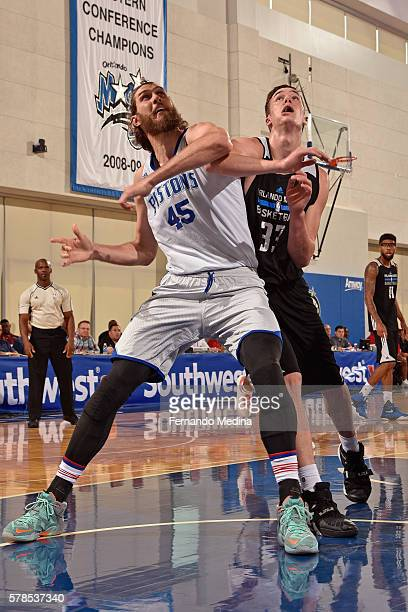 Jordan Bachynski of Detroit Pistons and Stephen Zimmerman of Magic Blue fight for a rebound during the 2016 Orlando Summer League on July 4 2016 at...