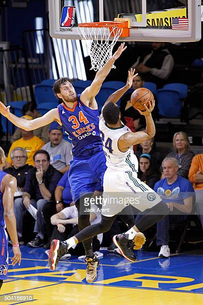 Jordan Bachynski of the Westchester Knicks blocks a shot against the Reno Bighorns during the 2016 NBA DLeague Showcase on January 8 2016 at Kaiser...