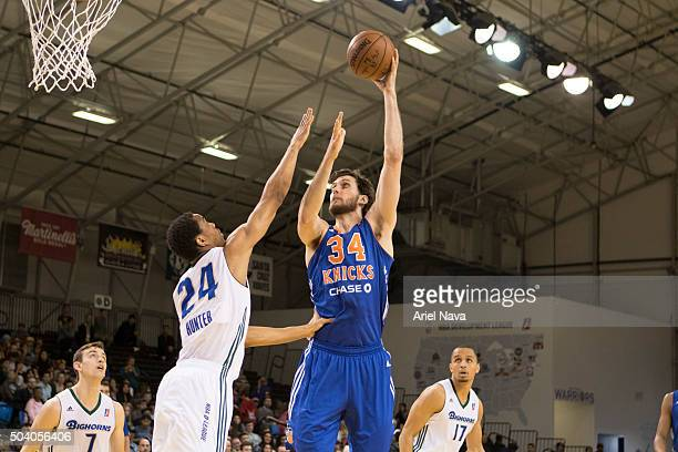 CRUZ CA JANUARY 8 Jordan Bachynski of the Westchester Knicks shoots over the Reno Bighorns defense during an NBA DLeague game on JANUARY 8 2016 in...