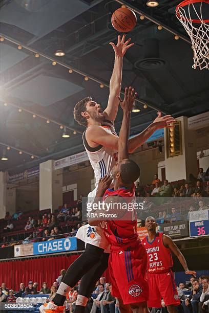 Jordan Bachynski of the Westchester Knicks shoots the ball against the Grand Rapids Drive at the Westchester County Center on December 10 2015 in...
