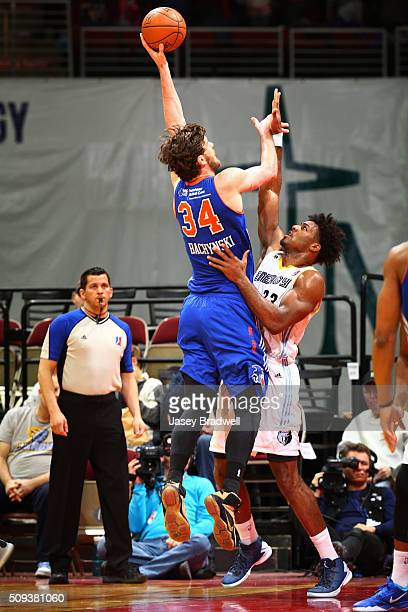 Jordan Bachynski of the Westchester Knicks shoots the ball over Alex Stepheson of the Iowa Energy in an NBA DLeague game on February 9 2016 at the...