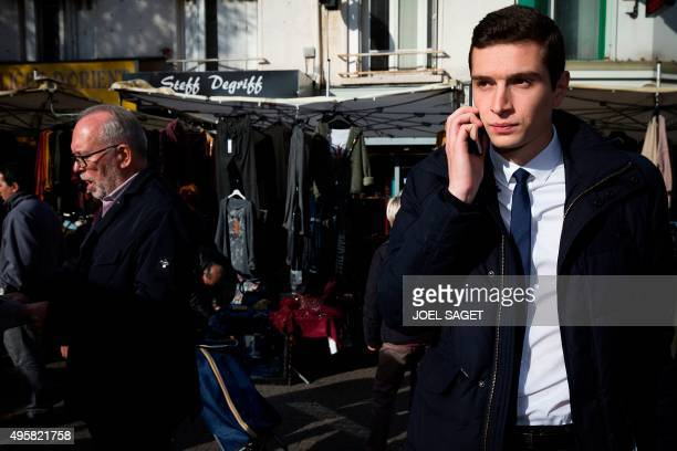 Jordan Bardella Front National farright party's top candidate in SeineSaintDenis for the upcoming regional elections visits a market with FN top...
