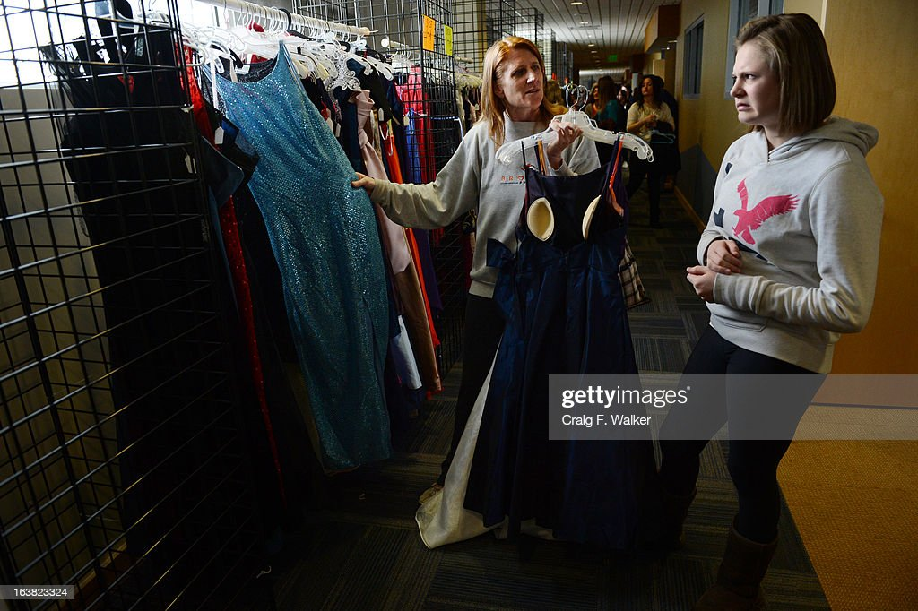 Jordan Beeson, a freshman at Faith Christian Academy, reacts to a dress while shopping with her mother, Lisa, at the Prom Dress Exchange Corp. event in Commerce City, CO March 16, 2013. With a valid student ID and a suggested $10 donation, teenage girls could chose from 1,356 donated dresses that lined a long hallway at Dick's Sporting Goods Park. Lisa said, 'I think it's amazing... to have an opportunity to not break the bank for a one night event. That's awesome.'