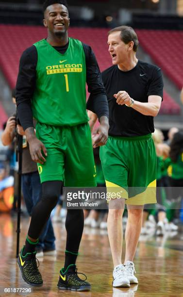 Jordan Bel and head coach Dana Altman of the Oregon Ducks talk during practice ahead of the 2017 NCAA Men's Final Four at University of Phoenix...