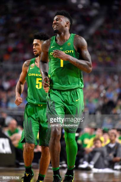Jordan Bell and Tyler Dorsey of the Oregon Ducks run up the court during the 2017 NCAA Men's Final Four Semifinal against the North Carolina Tar...