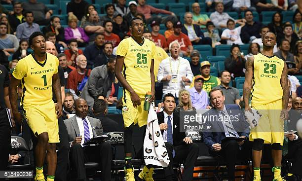 Jordan Bell Chris Boucher and Elgin Cook of the Oregon Ducks react to a teammate's shot late in the championship game of the Pac12 Basketball...