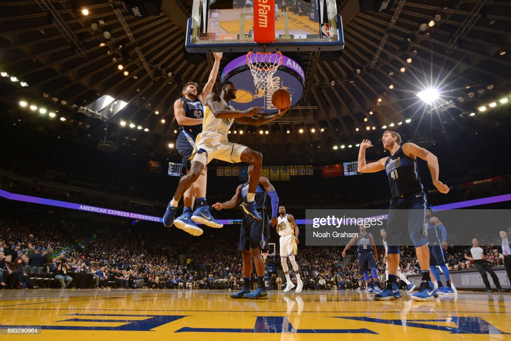 Jordan Bell #2 of the Golden State Warriors goes to the basket against the Dallas Mavericks on December 14, 2017 at ORACLE Arena in Oakland, California.