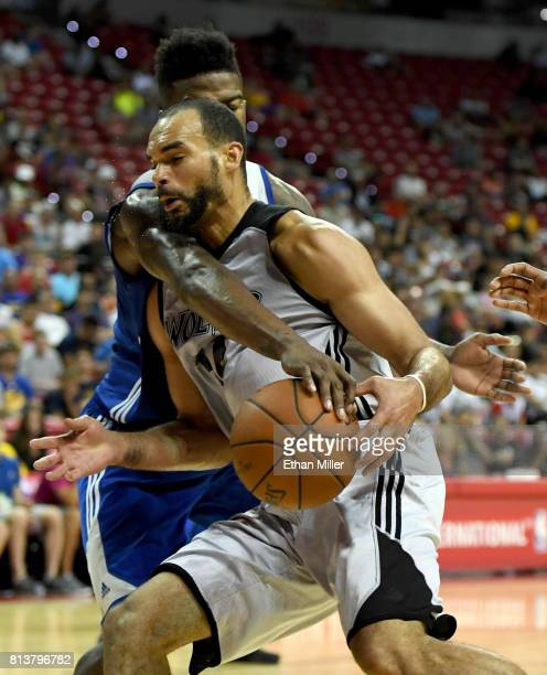 Jordan Bell of the Golden State Warriors tries to steal the ball from Perry Ellis of the Minnesota Timberwolves during the 2017 Summer League at the...