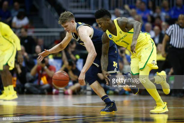 Jordan Bell of the Oregon Ducks and Moritz Wagner of the Michigan Wolverines chase a loose ball during the 2017 NCAA Men's Basketball Tournament held...