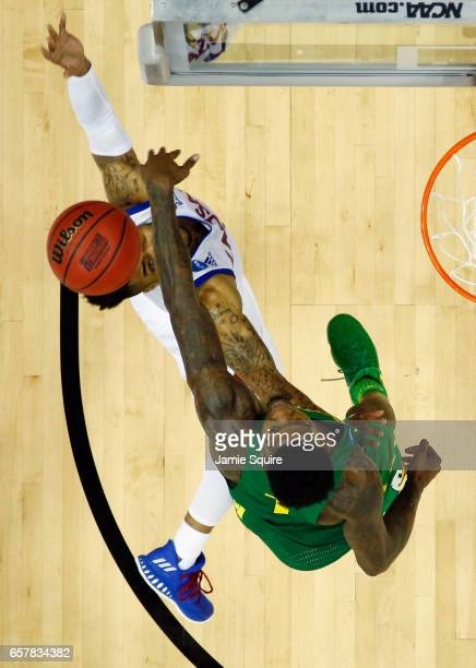 Jordan Bell of the Oregon Ducks blocks a shot by Frank Mason III of the Kansas Jayhawks in the second half during the 2017 NCAA Men's Basketball...