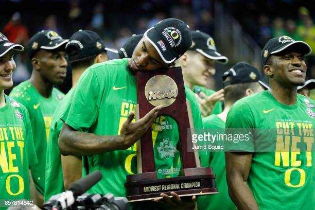 Jordan Bell of the Oregon Ducks celebrates with the 2017 Midwest Regional Champion trophy after defeating the Kansas Jayhawks 7460 during the 2017...