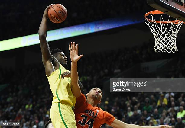Jordan Bell of the Oregon Ducks goes up for a dunk on Ben Kone of the Oregon State Beavers in the first half of the game at Matthew Knight Arena on...