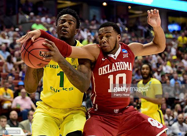 Jordan Bell of the Oregon Ducks is fouled by Jordan Woodard of the Oklahoma Sooners in the first half in the NCAA Men's Basketball Tournament West...