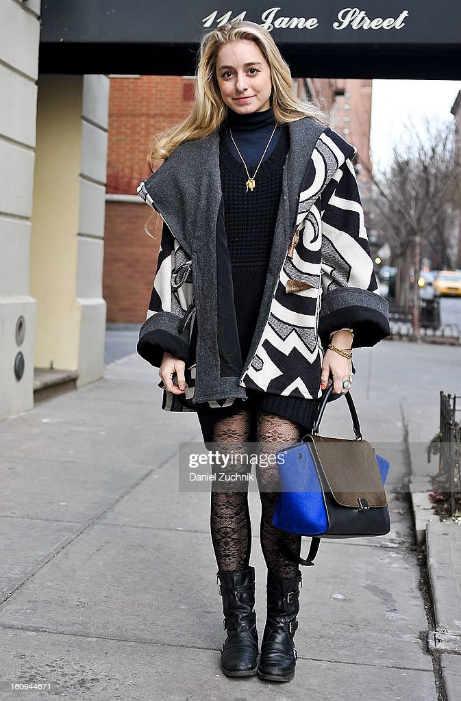 Jordan Blumberg, editor at Daily Candy, seen outside the Dannijo jewelry presentation wearing a Lindsey Thornburg cloak, Peak tights and a Celine bag on February 7, 2013 in New York City.