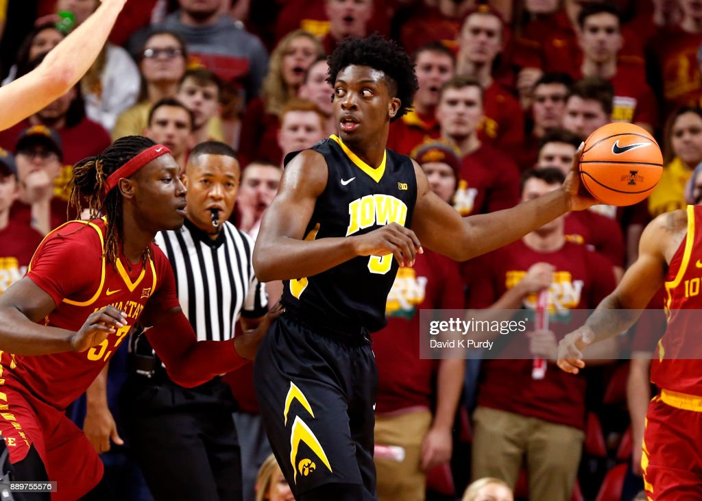 Jordan Bohannon #3 of the Iowa Hawkeyes passes the ball as Solomon Young #33 of the Iowa State Cyclones defends in the first half of play at Hilton Coliseum on December 7, 2017 in Ames, Iowa.
