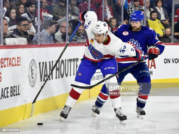 Jordan Boucher of the Laval Rocket defends the puck against Barry Goers of the Rochester Americans during the AHL game at Place Bell on October 25...