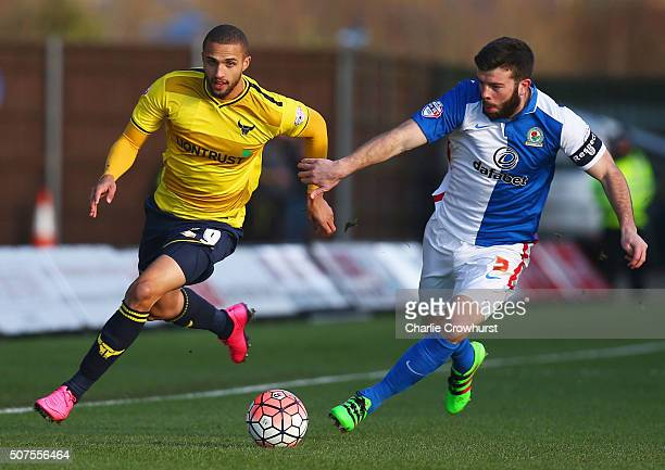 Jordan Bowery of Oxford United and Grant Hanley of Blackburn Rovers compete for the ball during The Emirates FA Cup fourth round match between Oxford...