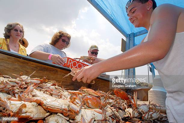Jordan Brown serving bluecrabs during the 30th annual J Millard Tawes Crab and Clam Bake in Crisfield Maryland