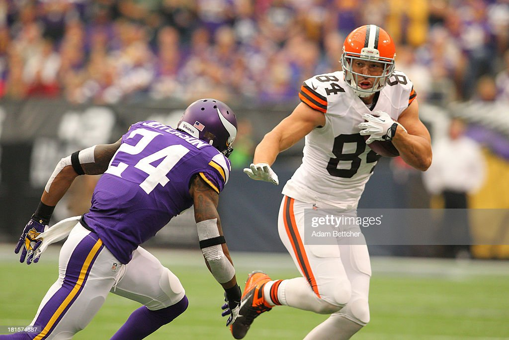<a gi-track='captionPersonalityLinkClicked' href=/galleries/search?phrase=Jordan+Cameron&family=editorial&specificpeople=5569295 ng-click='$event.stopPropagation()'>Jordan Cameron</a> #84 of the Cleveland Browns carries the ball while A.J. Jefferson #24 of the Minnesota Vikings applies pressure on September 22, 2013 at Mall of America Field at the Hubert Humphrey Metrodome in Minneapolis, Minnesota.
