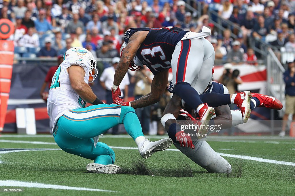Jordan Cameron #84 of the Miami Dolphins scores a touchdown during the fourth quarter against the New England Patriots at Gillette Stadium on September 18, 2016 in Foxboro, Massachusetts.