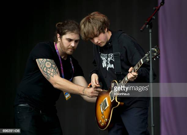 Jordan Cardy also known as Rat Boy gets help from a roadie whilst performing at The Parklife Festival 2017 at Heaton Park on June 10 2017 in...