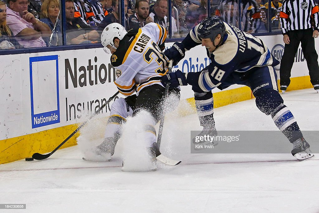 <a gi-track='captionPersonalityLinkClicked' href=/galleries/search?phrase=Jordan+Caron&family=editorial&specificpeople=5104084 ng-click='$event.stopPropagation()'>Jordan Caron</a> #38 of the Boston Bruins and <a gi-track='captionPersonalityLinkClicked' href=/galleries/search?phrase=R.J.+Umberger&family=editorial&specificpeople=636608 ng-click='$event.stopPropagation()'>R.J. Umberger</a> #18 of the Columbus Blue Jackets battle for control of the puck during the third period on October 12, 2013 at Nationwide Arena in Columbus, Ohio. Boston defeated Columbus 3-1.