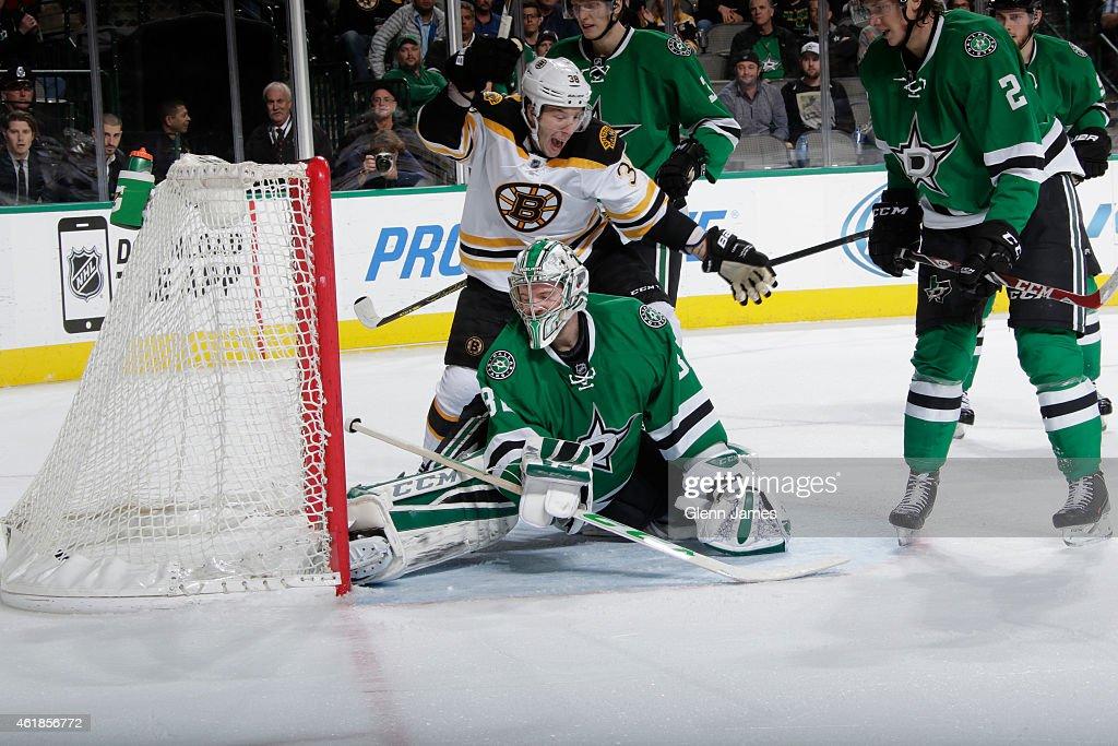 Jordan Caron of the Boston Bruins celebrates a goal against Kari Lehtonen of the Dallas Stars at the American Airlines Center on January 20 2015 in...