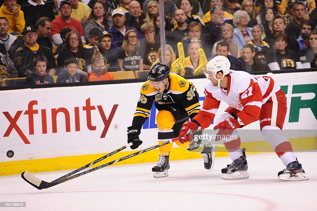 <a gi-track='captionPersonalityLinkClicked' href=/galleries/search?phrase=Jordan+Caron&family=editorial&specificpeople=5104084 ng-click='$event.stopPropagation()'>Jordan Caron</a> #38 of the Boston Bruins fights for the puck against the Detroit Red Wings at the TD Garden on October 5, 2013 in Boston, Massachusetts.