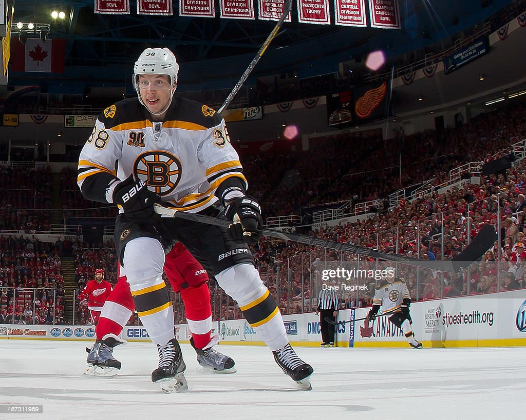 Jordan Caron of the Boston Bruins follows the play against the Detroit Red Wings during Game Four of the First Round of the 2014 Stanley Cup Playoffs...