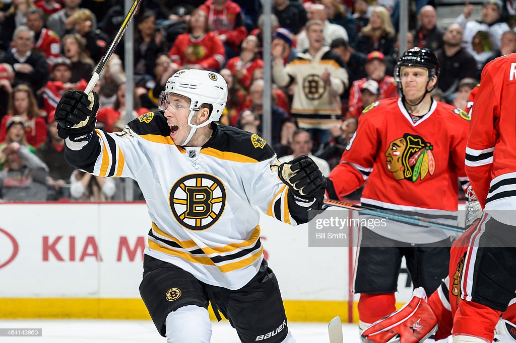 <a gi-track='captionPersonalityLinkClicked' href=/galleries/search?phrase=Jordan+Caron&family=editorial&specificpeople=5104084 ng-click='$event.stopPropagation()'>Jordan Caron</a> #38 of the Boston Bruins reacts after the Bruins scored against the Chicago Blackhawks in the second period as <a gi-track='captionPersonalityLinkClicked' href=/galleries/search?phrase=Kris+Versteeg&family=editorial&specificpeople=2242969 ng-click='$event.stopPropagation()'>Kris Versteeg</a> #23 stands in the background during the NHL game at the United Center on February 22, 2015 in Chicago, Illinois.