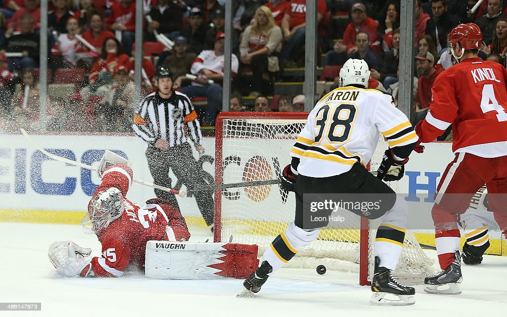 Jordan Caron #38 of the Boston Bruins scores a first-period goal on golie Jimmy Howard #35 of the Detroit Red Wings against the Detroit Red Wings in Game Three of the First Round of the 2014 NHL Stanley Cup Playoffs at Joe Louis Arena on April 22, 2014 in Detroit, Michigan.