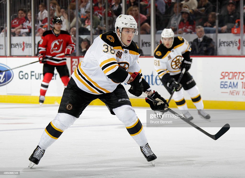Jordan Caron of the Boston Bruins skates against the New Jersey Devils at the Prudential Center on April 13 2014 in Newark New Jersey