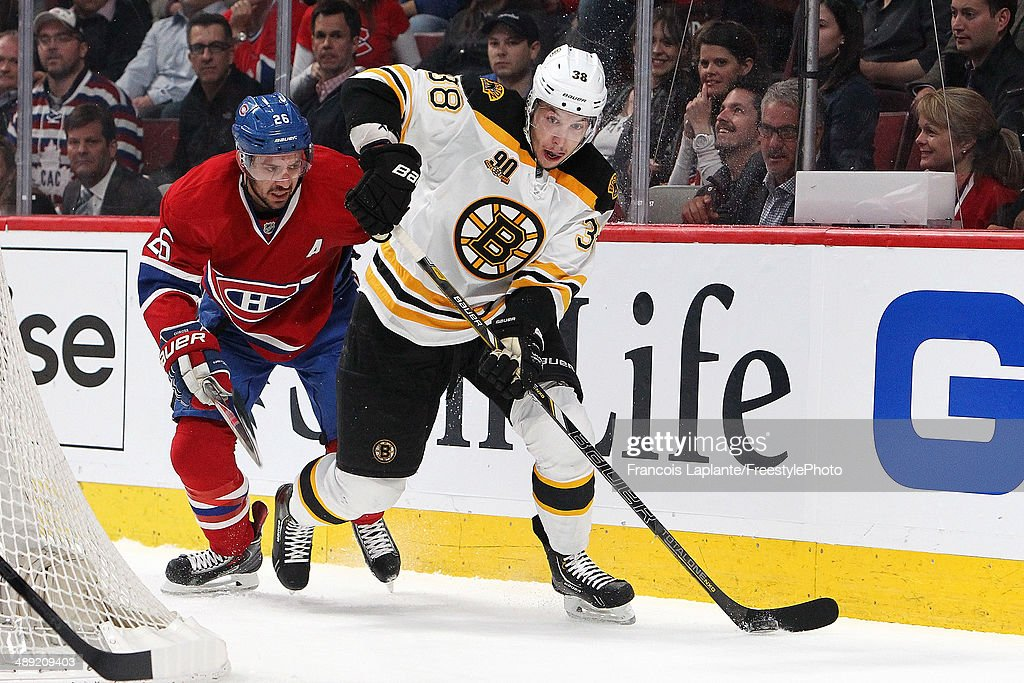 Jordan Caron of the Boston Bruins skates with the puck against Josh Gorges of the Montreal Canadiens in Game Three of the Second Round of the 2014...