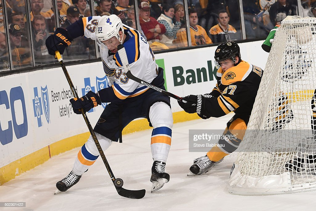 Jordan Caron of the St Louis Blues skates against Torey Krug of the Boston Bruins at the TD Garden on December 22 2015 in Boston Massachusetts