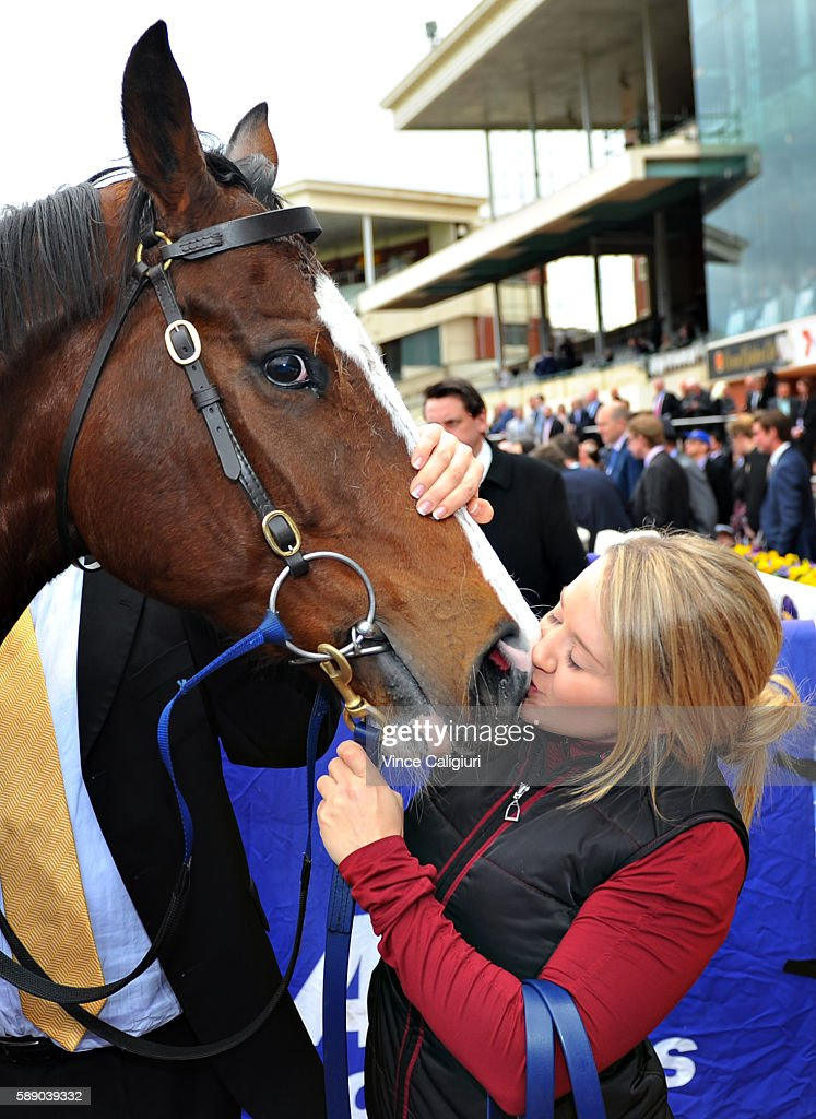 Jordan Chalmers gives Miss Rose de Lago a kiss after winning Race 7 PB Lawrence Stakes during Melbourne Racing at Caulfield Racecourse on August 13...
