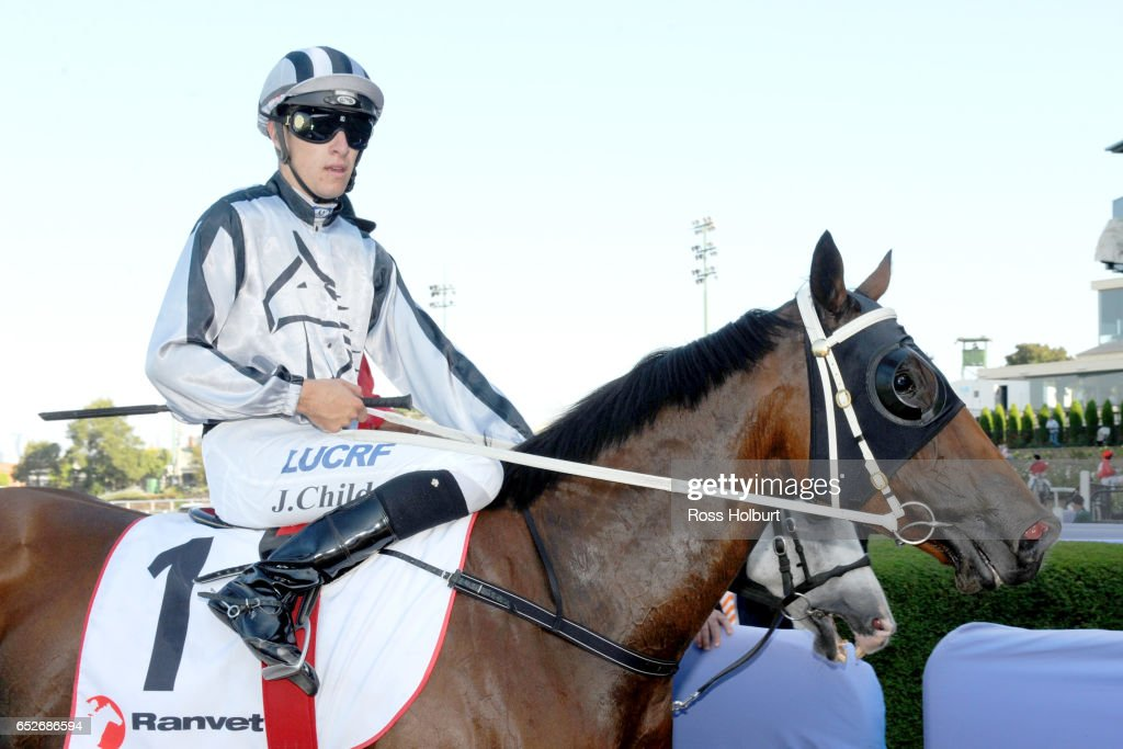 Jordan Childs returns to the mounting yard on Bel Burgess after winning Ranvet Handicap at Moonee Valley Racecourse on March 13, 2017 in Moonee Ponds, Australia.