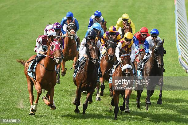 Jordan Childs riding Leica Day comes to first turn before winning Race 6 at Moonee Valley Racecourse on January 2 2016 in Melbourne Australia