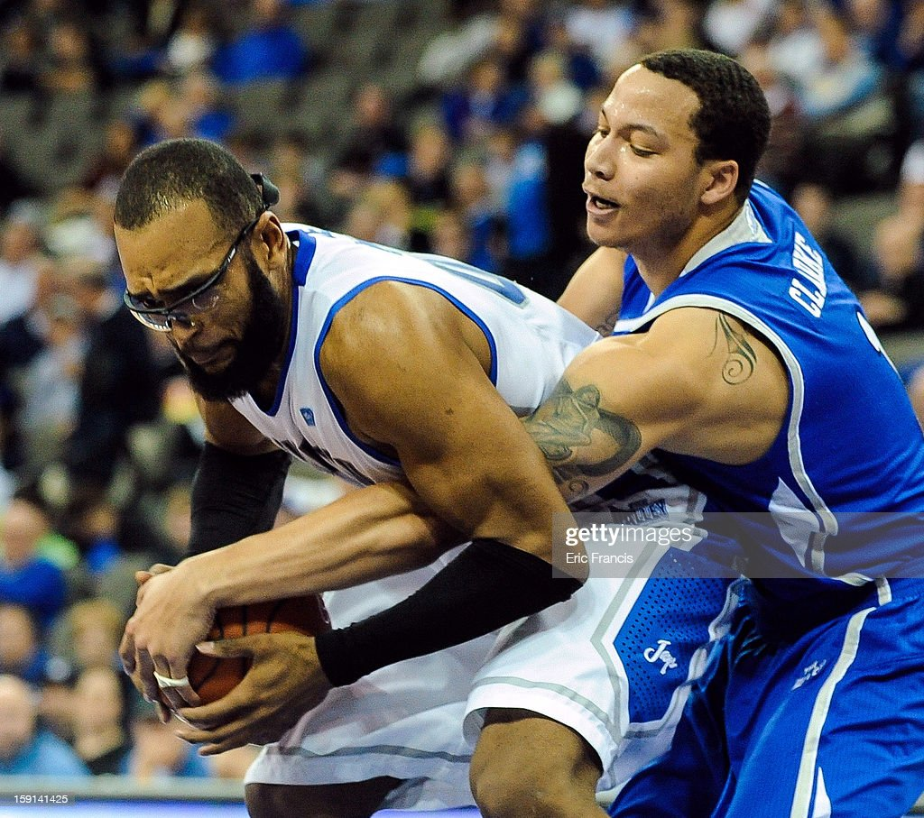 Jordan Clarke #1 of the Drake Bulldogs and <a gi-track='captionPersonalityLinkClicked' href=/galleries/search?phrase=Gregory+Echenique&family=editorial&specificpeople=5648736 ng-click='$event.stopPropagation()'>Gregory Echenique</a> #00 of the Creighton Bluejays fight for a rebound during their game at the CenturyLink Center on January 8, 2013 in Omaha, Nebraska. Creighton defeated Drake 91-61.