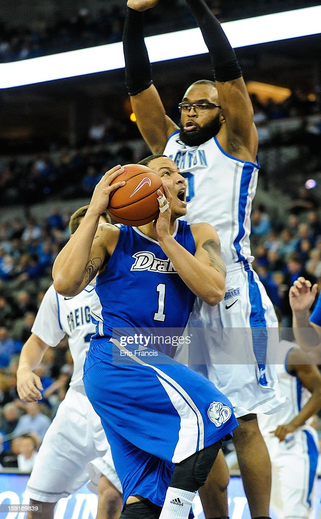 Jordan Clarke #1 of the Drake Bulldogs drives past Gregory Echenique #00 of the Creighton Bluejays during their game at the CenturyLink Center on January 8, 2013 in Omaha, Nebraska. Creighton defeated Drake 91-61.