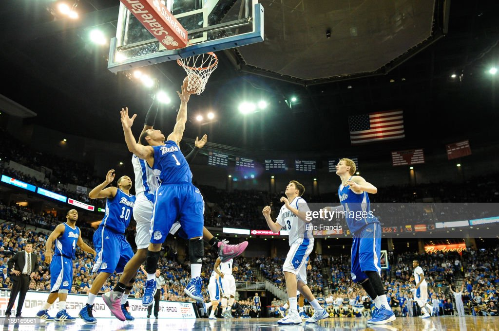 Jordan Clarke #1 of the Drake Bulldogs works for a rebound against <a gi-track='captionPersonalityLinkClicked' href=/galleries/search?phrase=Gregory+Echenique&family=editorial&specificpeople=5648736 ng-click='$event.stopPropagation()'>Gregory Echenique</a> #00 of the Creighton Bluejays during their game at the CenturyLink Center on January 8, 2013 in Omaha, Nebraska. Creighton defeated Drake 91-61.