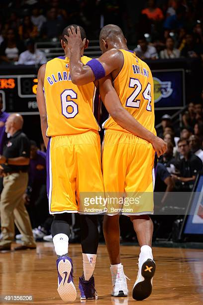 Jordan Clarkson and Kobe Bryant of the Los Angeles Lakers huddle during a preseason game against the Utah Jazz at the Stan Sheriff Center on October...
