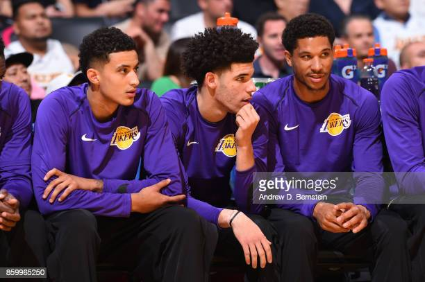 Jordan Clarkson Lonzo Ball and Josh Hart of the Los Angeles Lakers react to a play during a preseason game against the Utah Jazz on October 10 2017...